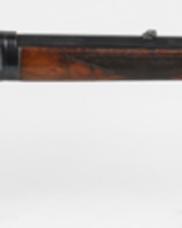 Deluxe Special Order Winchester Model 1894 rifle, .30-.35 caliber, 26-inch half-octagon barrel, serial number applied in 1907.