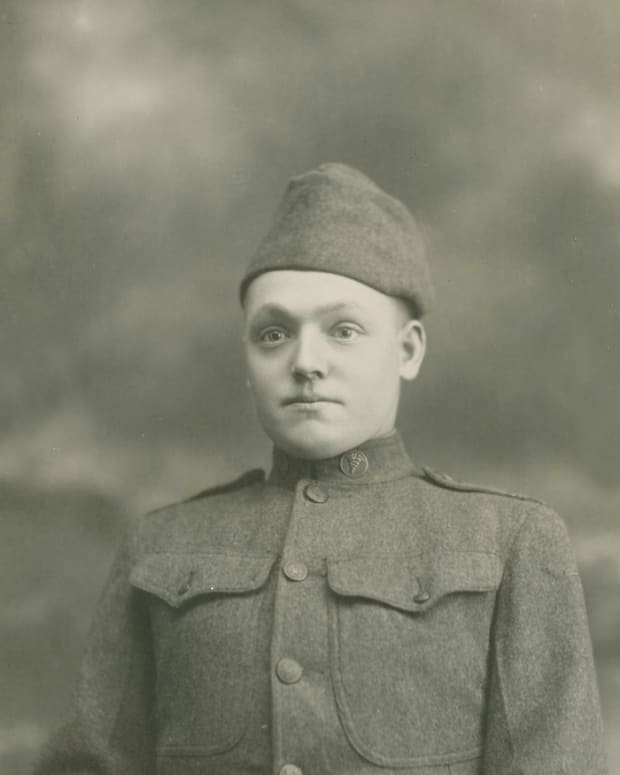 Private James F. Callahan, Co. F, 17th Evacuation Hospital, Siberian Expeditionary Force posed wearing his 1907 pattern cap backwards as was often suggested by photographers.