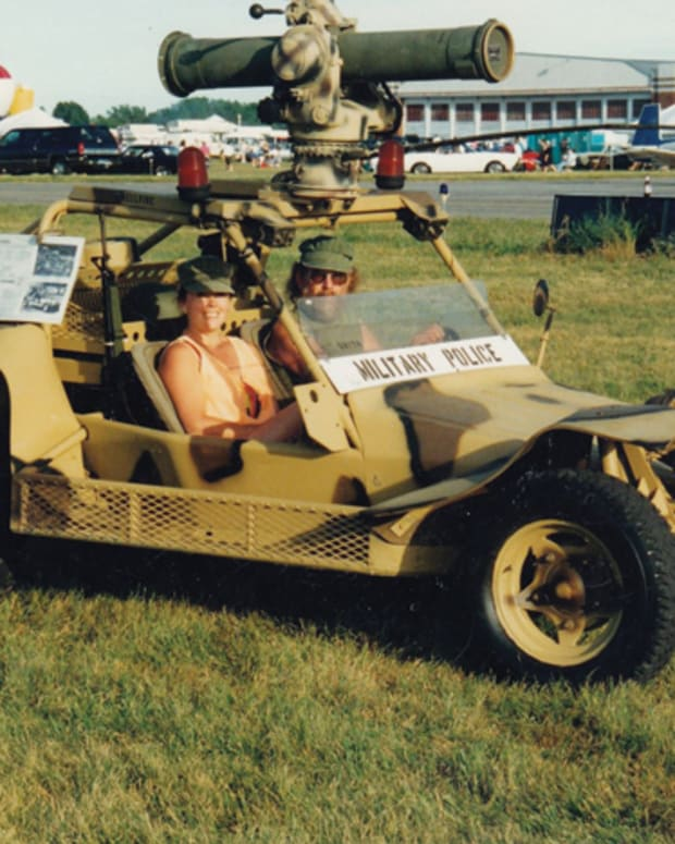"Ken Roggow wrote, ""My wife and I taking a friends fast attack vehicle for a drive at the Jackson, MI air show."""