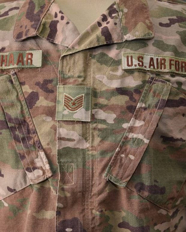 The Air Force's new Operational Camouflage Uniform has a smaller rank insignia displayed in the middle of the chest. The Air Force is switching to a lighter, three-color background for the Trank insignia, service and name tapes, and badges.