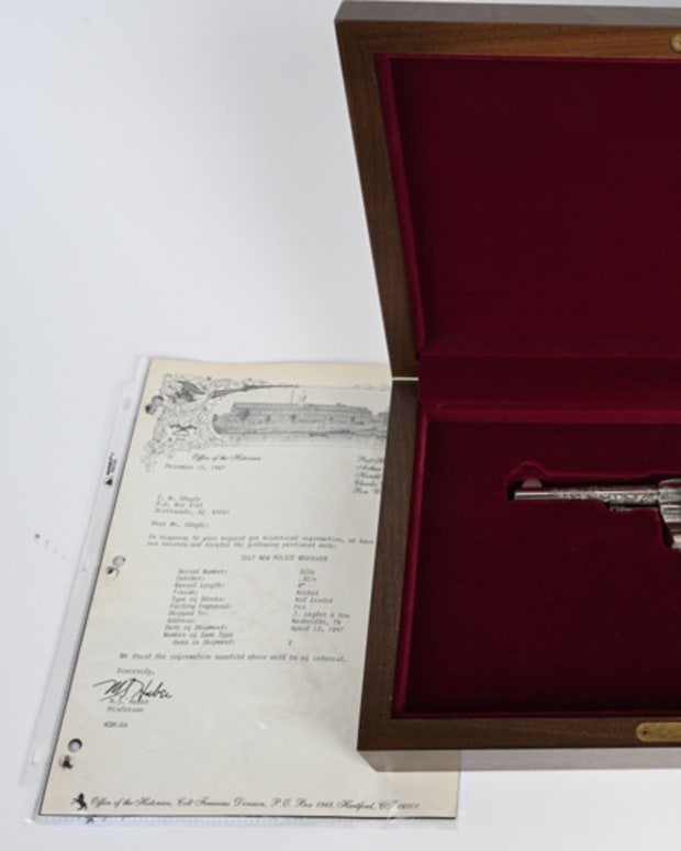 Antique 1897 Colt .32-caliber 'New Police' revolver with American-scroll engraving by Cuno Helfricht. Solid 99% gun with near-mint bore and action. Comes in modern Colt walnut fitted case.
