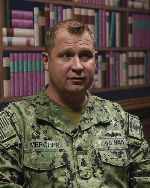 Senior Chief Damage Controlman William Merchen, a hero of the attack on the Arleigh Burke-class guided-missile destroyer USS Cole (DDG 67) on Oct. 12, 2000, while moored for refueling in the Port of Aden, Yemen. Merchen received the Meritorious Mertit Medal for his actions.