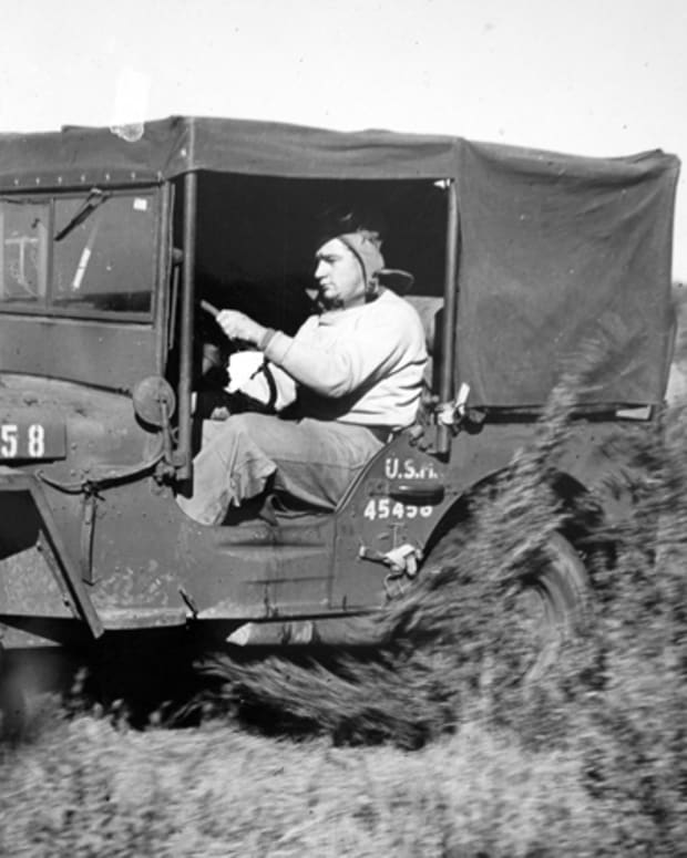 This is the Holden Jeep in its original form. Faintly visible through the glass is a Stokes basket. Special canvas cab covers were created for the Holden Jeeps, which contributed to their boxy looks.