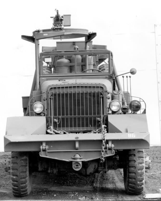 The Series Five trucks had a very business-like front end. A whiffle tree is affixed to the chisel-shaped front bumper, and the two spares, as well as the torch set are visible through the windshield. While this particular truck is equipped with a ring mount and .50 caliber machine gun, this was not always the case.