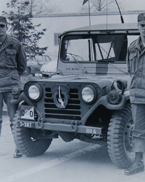 "Dennis D. Dop (right) was the driver for Lieutenant Colonel (later, Major General) Pete McVey, commander of the 34d Squadron, 7th Cavalry. Dop selected this M151A2 ""Mutt"" in July 1974 because of the vehicle's number: ""NBC04P"". His wife was pregnant with their first child and he liked the ""4P"" (""for Papa"")."