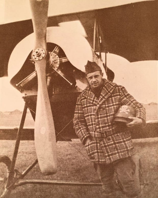 Wartime photo shows Parsons holding his helmet in front of his Escadrille plane.