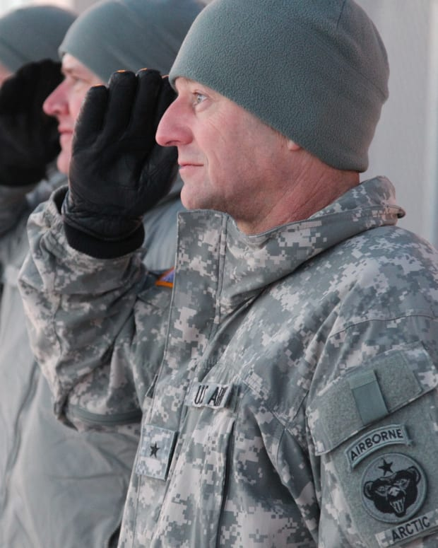 USARAK commander Gen. Raymond Palumbo is wearing the old-style rectangular tab as he stood at attention in -23 degrees temperature, rendering a salute as U.S. Army Chief of Staff, Gen. George Casey, departed Alaska in December 2010.