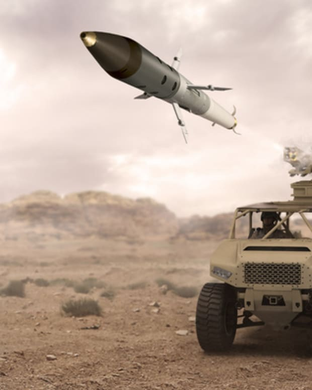 Artist's concept of a vehicle-mounted launch of an APKWS laser-guided rocket.