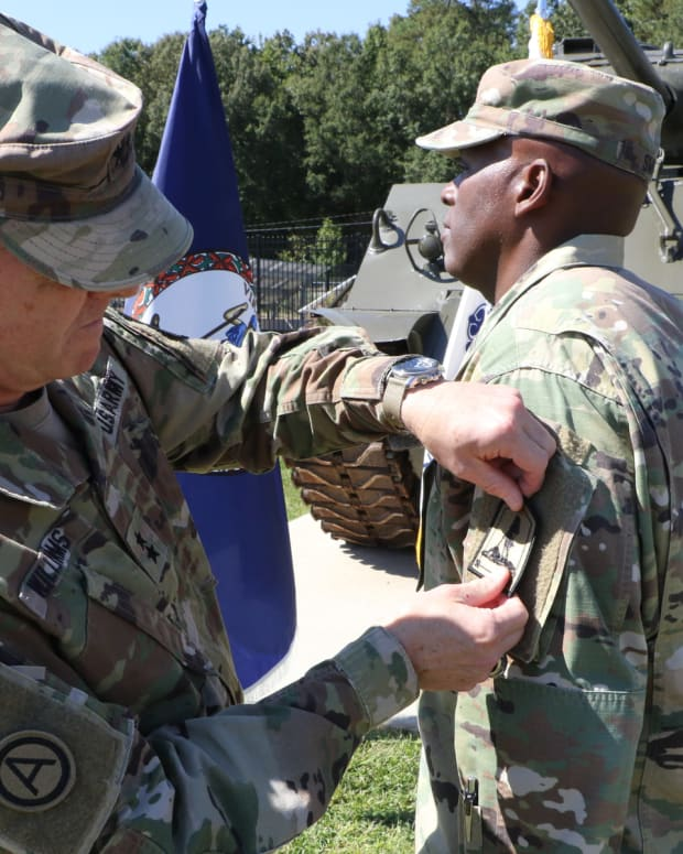 MG Timothy Williams places the new VANG JF HQ patch on the left sleeve of Command Sergeant Major Ronald Smith at the September 28, 2021, ceremony.