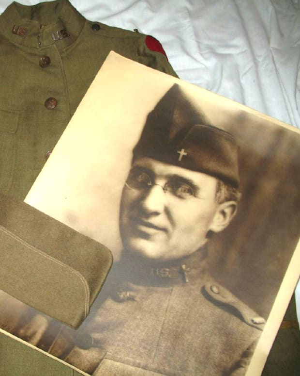 The large U.S. Signal Corps portrait of Father Arthur A. LeMay was purchased more than thirty years ago at a VFW tag sale for $1. The portrait reunited with LeMay's tunic and overseas cap in 2008.