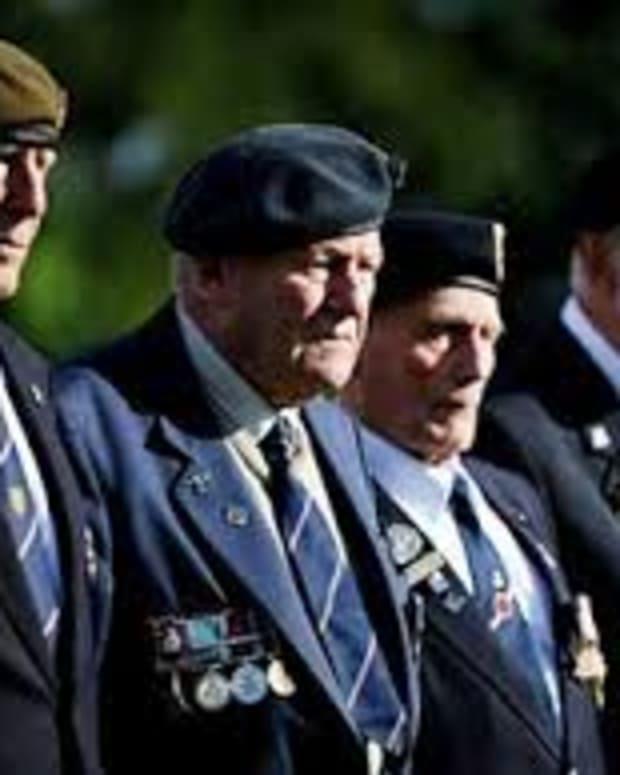 British World War II veterans visit the war cemetery of Ranville, northwestern France, on June 4, 2014.