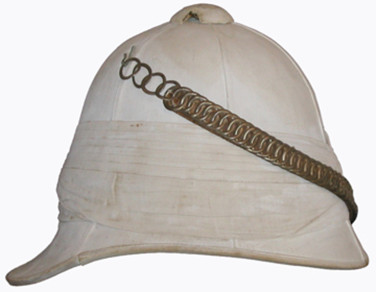Despite what movies suggest, the Foreign Service Helmet was typically worn without a badge. Officers' helmets utilized the same type of chin scales as the Home Service Helmet. This example was formerly owned by Major C. Venables-Llewelyn of the Glamorgan Imperial Yeomanry. It was produced by Hamburger Rogers & Son, King Street, Covent Garden, London.