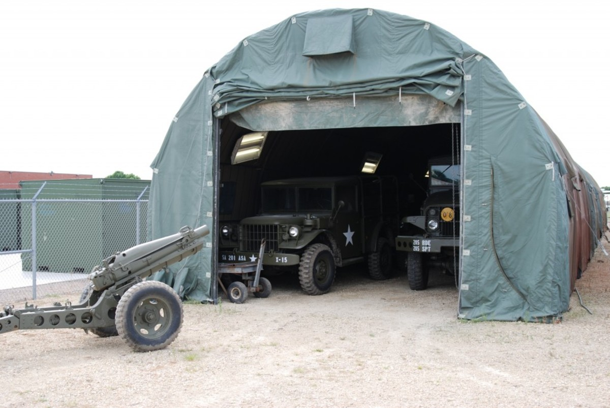 Though much of the Fort Snelling Military Museum collection is stored outdoors, vehicles are housed in temporary shelters as they are restored.