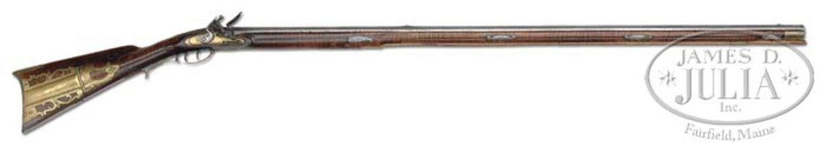 A relief-carved Fredrick Sell flintlock rifle. Presale estimate of $65,000-$75,000.