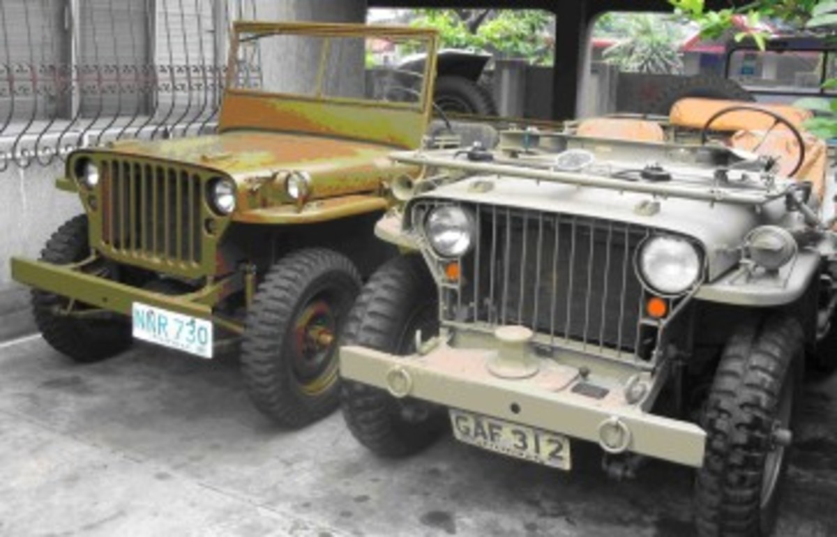 """A restored GPW with MDJuan galvanized iron body, and an early MB with original"""" block Willys"""" body, capstan winch, modified with 7"""" headlights, but with a GPW frame and blackout marker lights modified for turn signals."""
