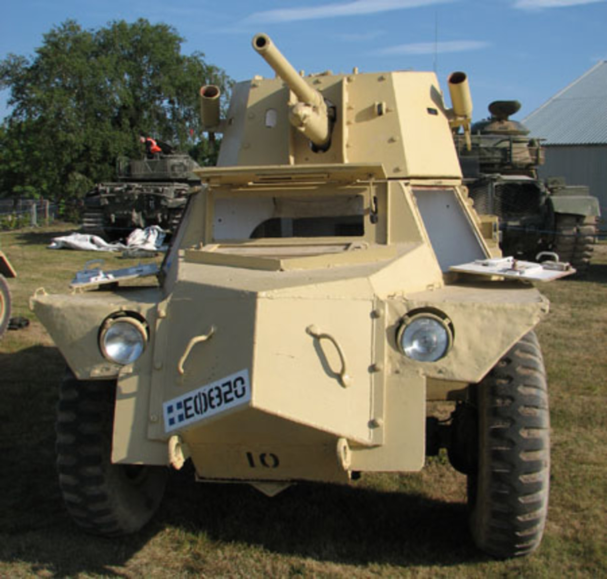 """The turret-mounted two-pound gun had elevation and depression and with full 360 degree traverse could engage targets easily. The gun fired """"fixed ammunition"""" of the type used by the field gun in the anti-tank role which made it easier and faster to load. The recuperator under the barrel was a prominent feature."""