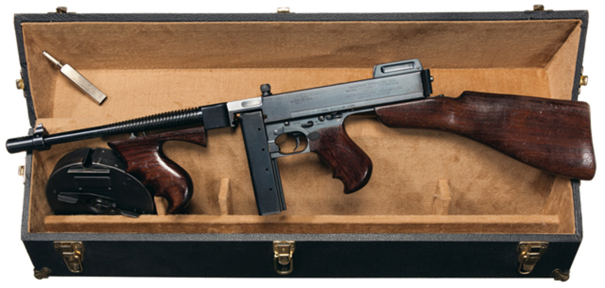 "Exceptional Colt, Model 1921/28 ""U.S. Navy"" Over Stamp Thompson Submachine Gun with Accessories and Carrying Case. $48,875."
