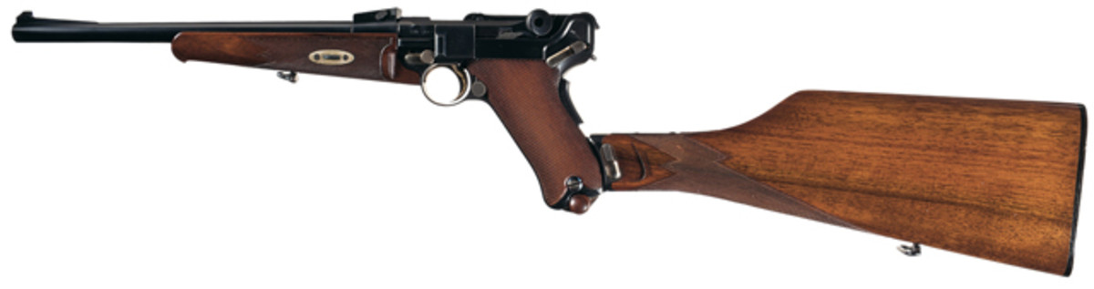 "Extraordinary DWM Luger Model 1902 Carbine Rig Complete with Matching Shoulder Stock, Ammunition, Cleaning Rod, and ""VL&A"" Chicago Marked Leather Carrying Case. $51,750."