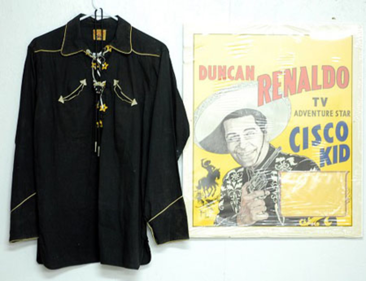 Shirt with bolo tie, guns and holsters worn by actor Duncan Renaldo on the TV show Cisco Kid.