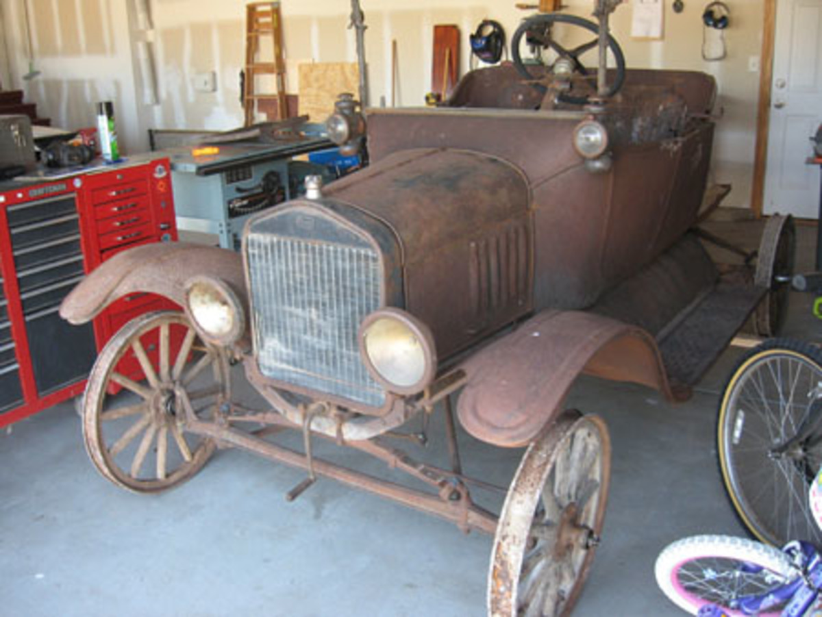 The Ford Model T project car off the trailer and rolled into the garage ready for disassembly.