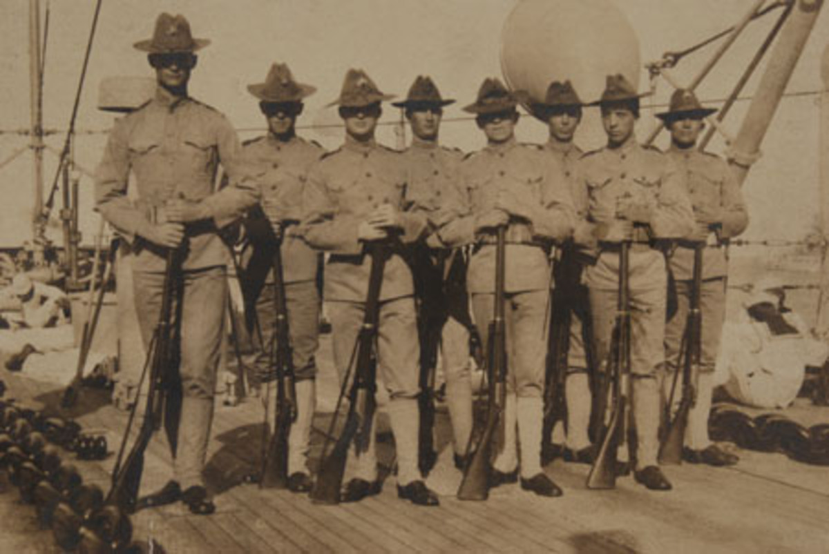 These shipboard Marines are wearing the predecessor to the P1912 hat, the fore-to-aft creased Pattern or 1898 hat. (Photo courtesy John Adams-Graf collection)