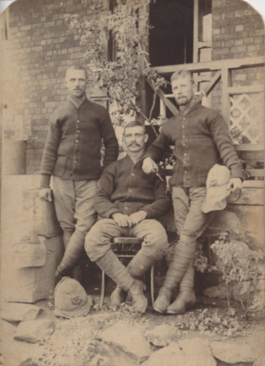 "Three soldiers of the Gloucestershire Regiment. Note the use of the curtains on the helmets, as well as the famous Gloucester ""Back Badge."""