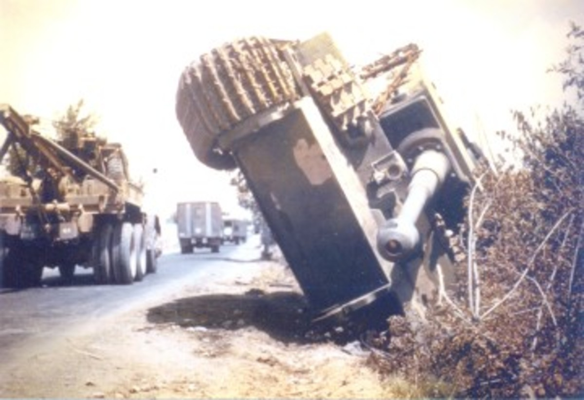 An M1A1 heavy wrecker, probably the most renowned of the Army's WWII recovery vehicles, roars past an overturned Tiger I during the Allied advance into Europe. Most of the movement of the M1A1's recovery gear was manually actuated. It wasn't until the introduction of the M62, that hydraulic recovery gear became standard.