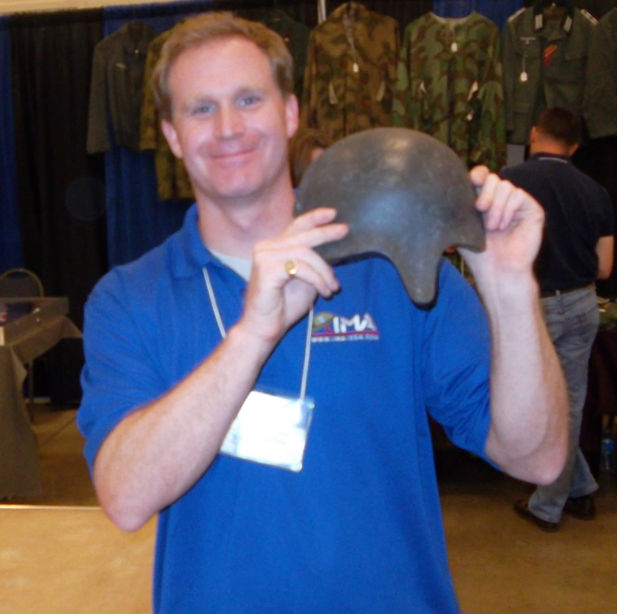 """Alex Cranmer of IMA-USA shows off his recent purchase, an early German skullcap often known as the """"Gaede helmet, after Army Group Gaede, which saw its development"""