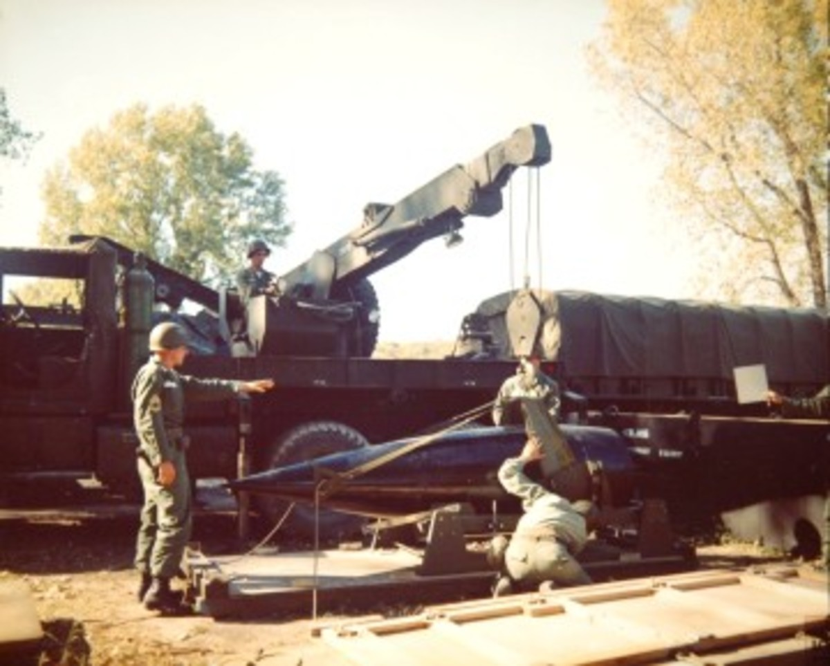 The first mass-produced M-series five ton wrecker, the M62, can be distinguished from the later M543 (with which it shared a chassis) by the spare tire mounted on the shipper.