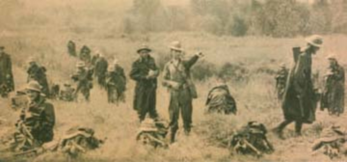 Troops are on the move in the field during the huge Louisiana Maneuvers exercise in 1941.