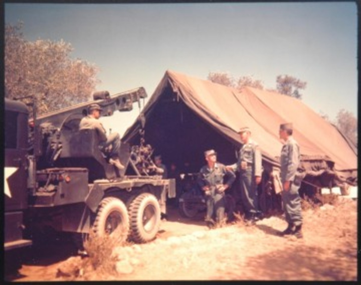 Considerably more difficult to find today than the five-ton wreckers are their 2-1/2-ton cousins, the M60 and M108. In this August 1958 scene in Beirut, a M108 serves as an engine hoist during Jeep maintenance.