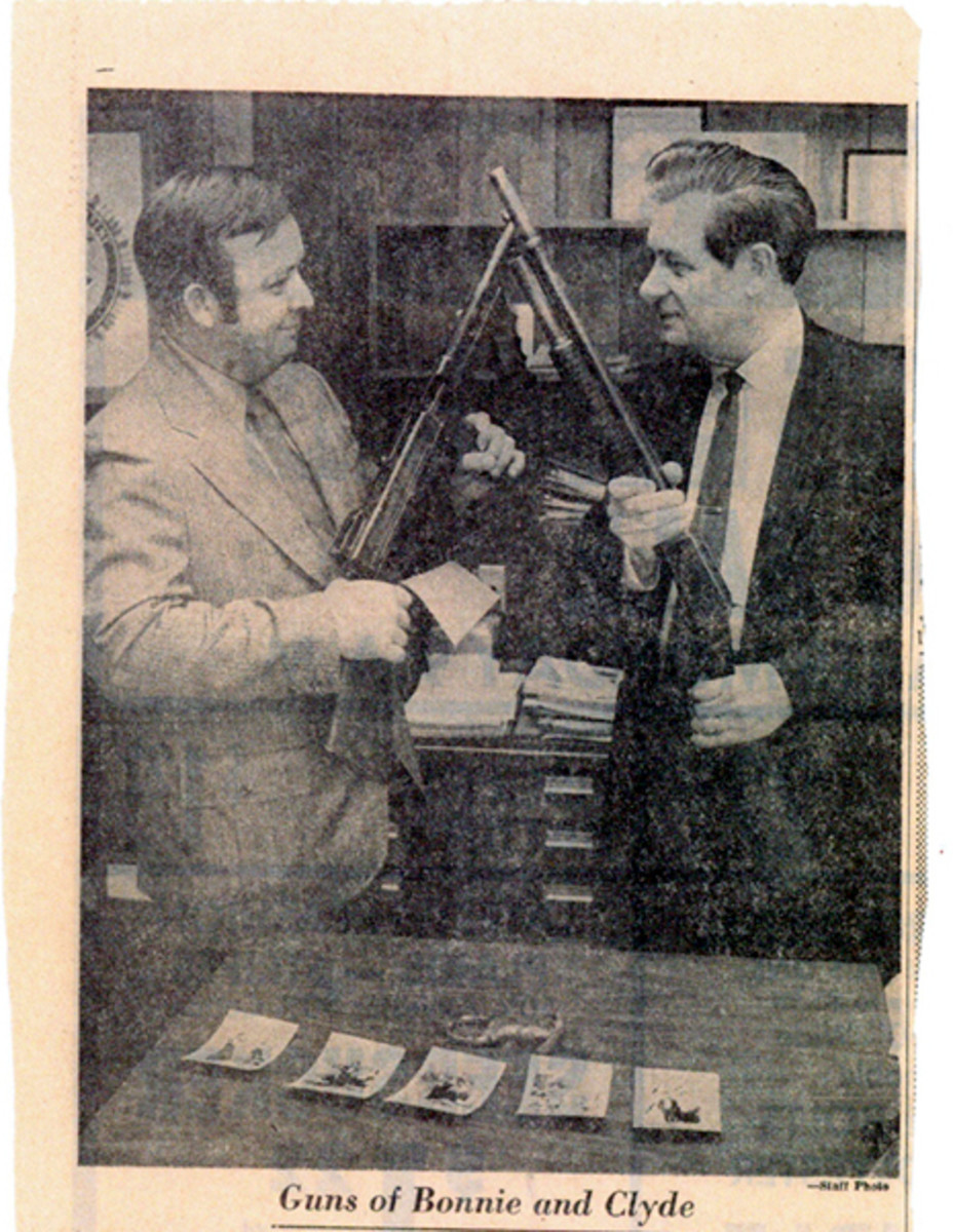Mark Lairmore (left), grandson of the policeman given the guns, presents them to Springfield (Mo.) Police Chief Gordon Loveland, for display at the Springfield Police Museum (1973-2011).