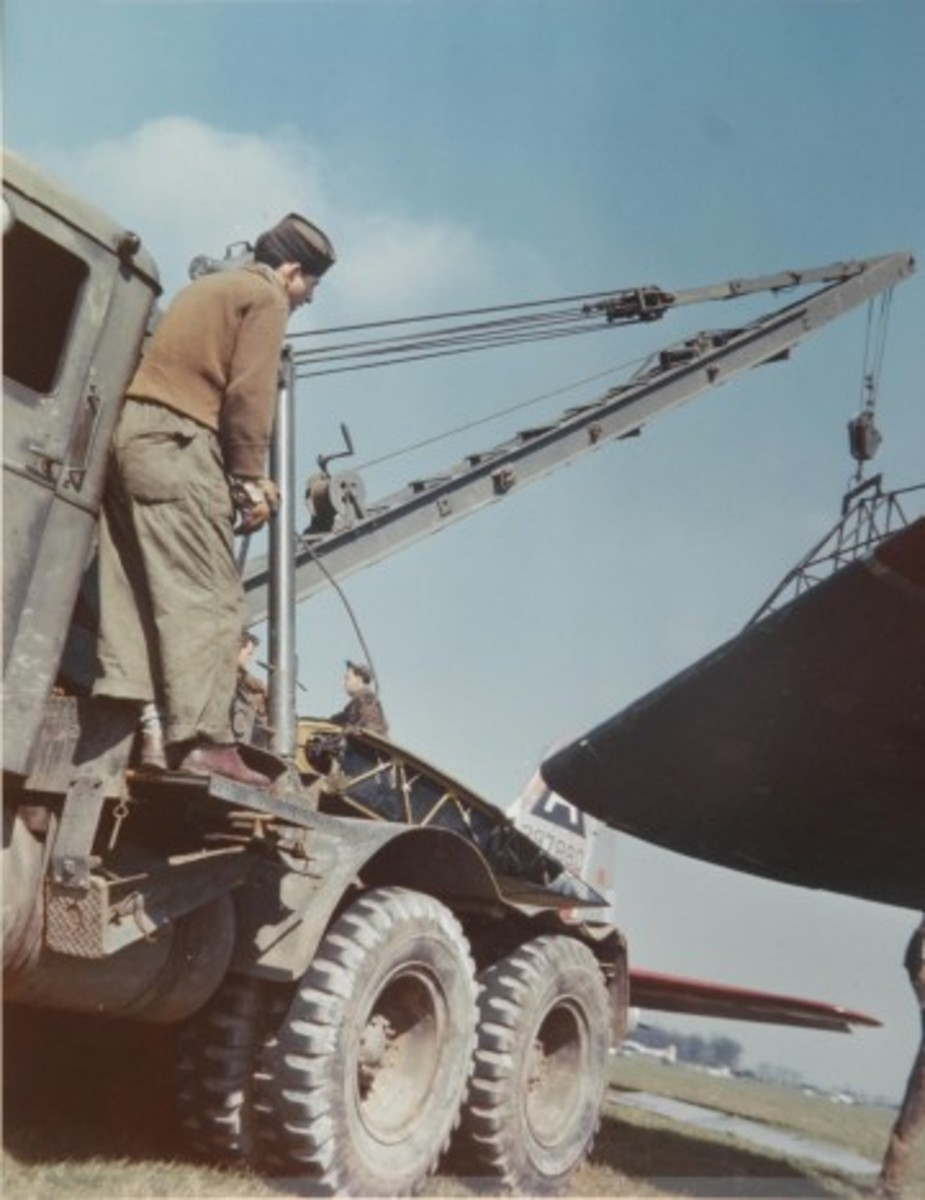 One of the more obscure wreckers--or vehicles of any sort--of WWII is the C2 Truck-Tractor. The Federal Model 606 truck was equipped with a Gar Wood US6T26 hoist, and was designed to be used in conjunction with a trailer for aircraft recovery and maintenance. Here one of the trucks is used to dismember a downed 8th Air Force B17 in England.
