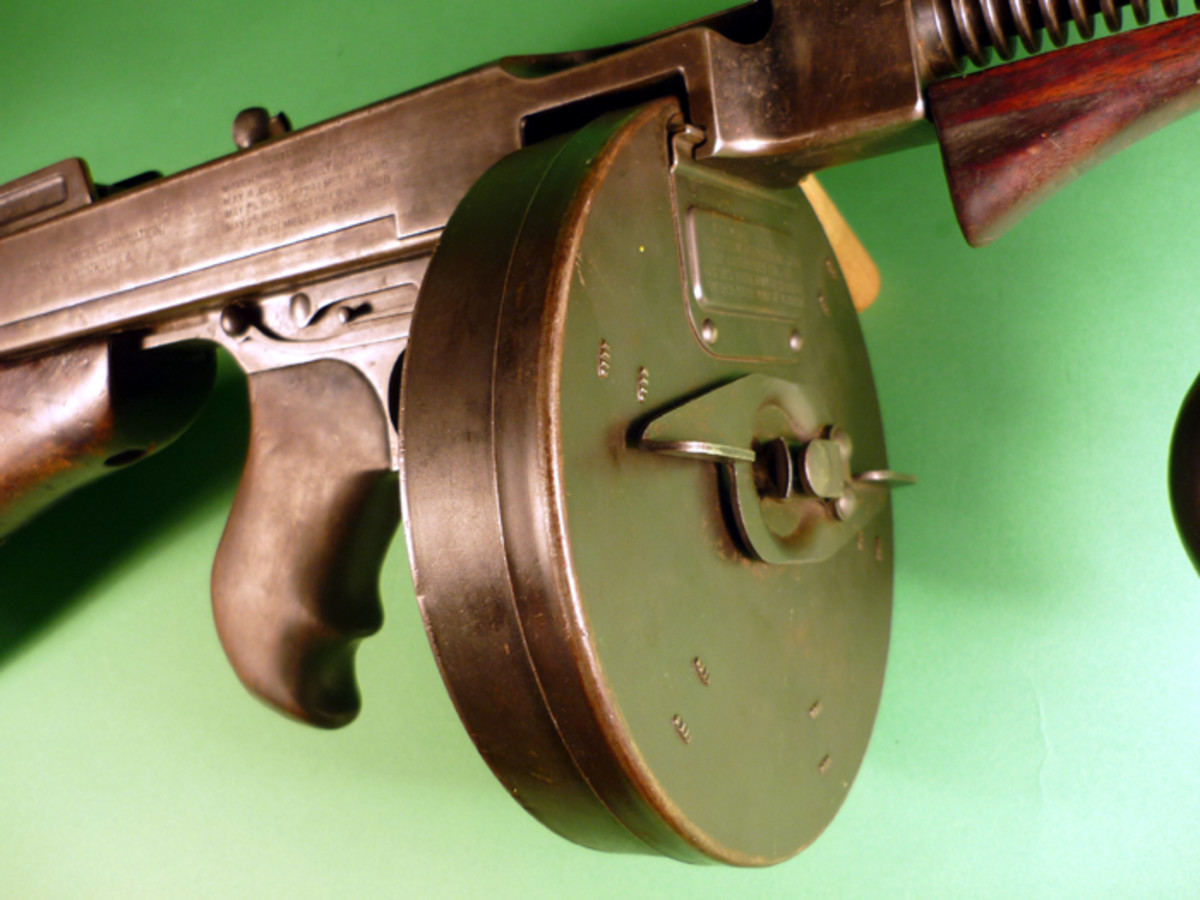 "Close-up view of the barrel portion of the Thompson (""Tommy gun"") sub-machine gun being sold."