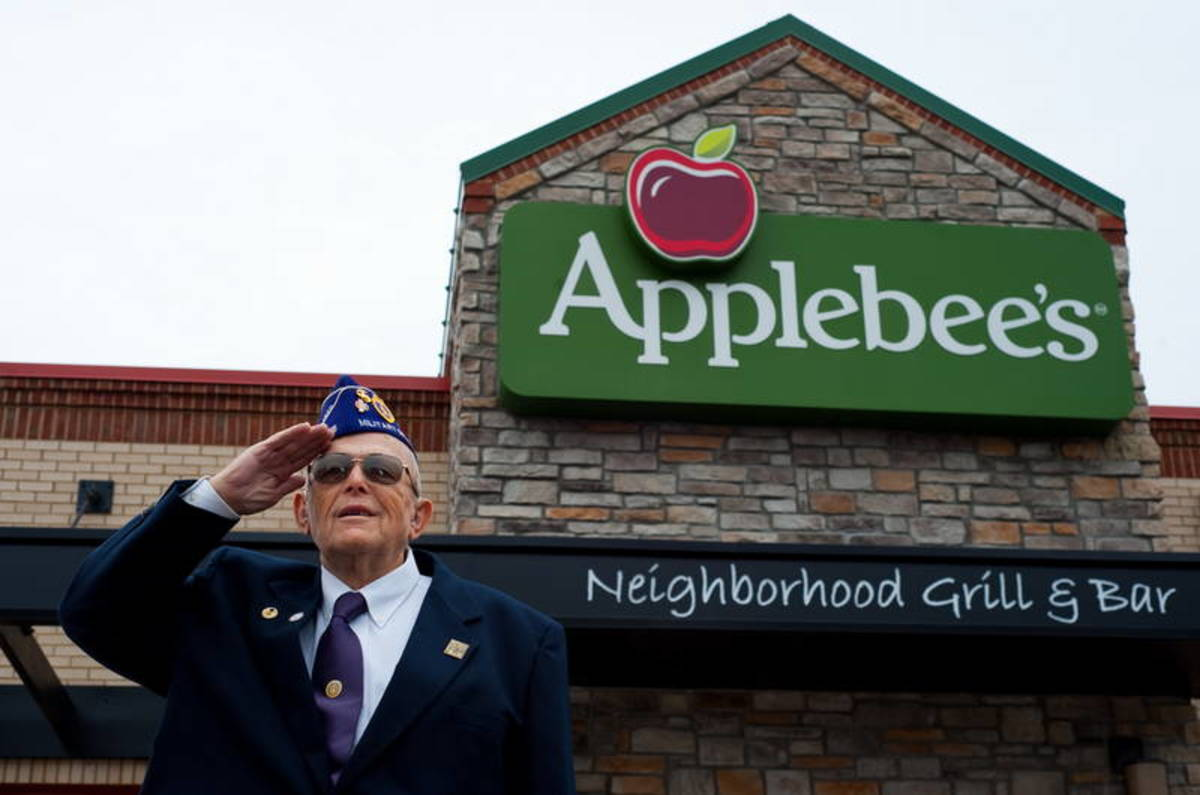 A veteran salutes at Applebee's, which will salute the nation's military this Veterans Day with free Thank You meals.