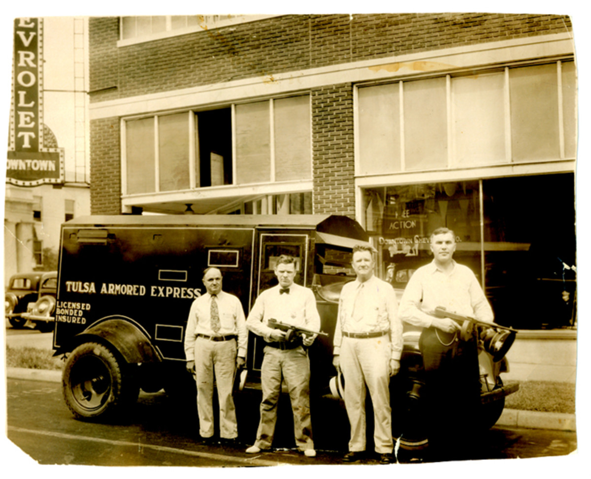 Mark Lairmore (far left), the man who was given the weapons, started an armored car business in Tulsa, Okla.