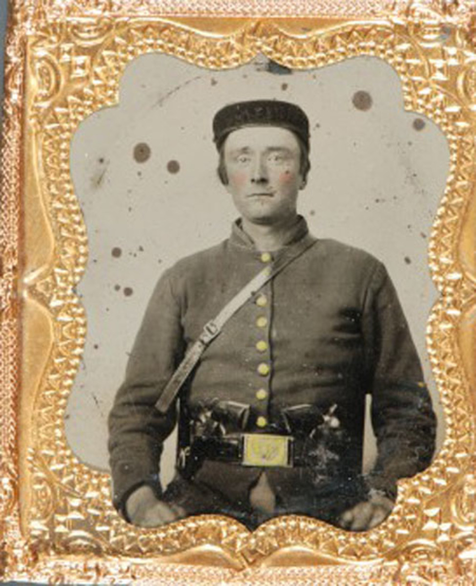 Cased, sixth plate tintype of a Union soldier wearing an infantry frock coat, forage cap and Model 1851 saber belt and armed with a brace of Colt revolvers was previously unidentified—even though the clues were before our eyes!