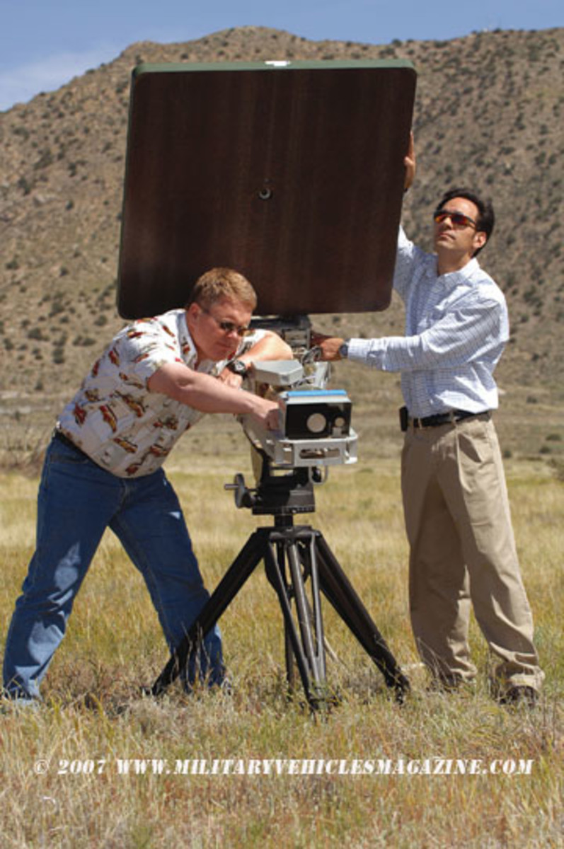 Sandia researchers Willy Morse and James Pacheco fine-tune the small-sized Active Denial System.