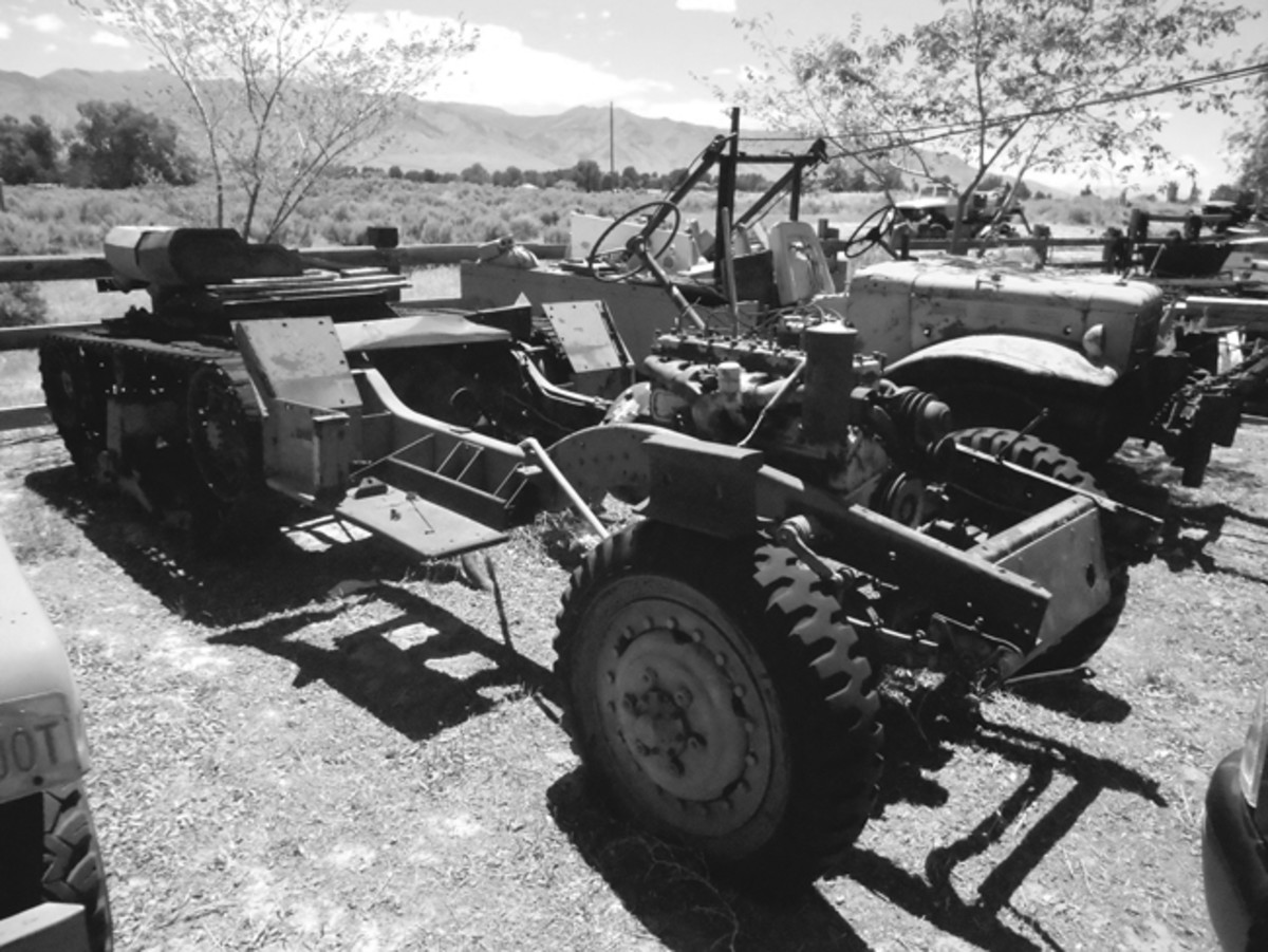 Another half-track chassis with a WC-52 in the background.