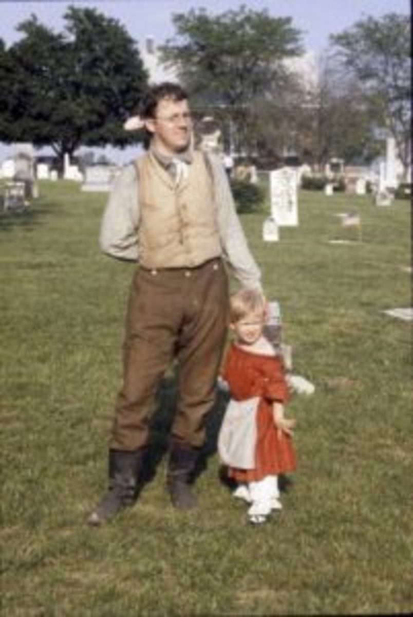 Many years ago: My daughter and I after our Fourth of July picnic in Shiloh Cemetery in Lerna, Illinois. She grew up – as I did – playing in cemeteries.