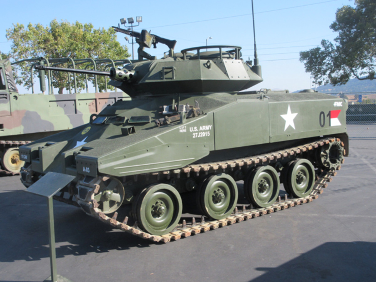 A rare FMC XM800T Armored Reconnaissance Scout Vehicle brought by Doug Boales from the Eagle Field Foundation. This prototype and an XM800W articulated, six-wheeled version built by Lockheed were the result of the Army's wish in the 1960s-70s for an armored scout vehicle with troop carrying capability that upgraded the M113. The XM800T carried a crew of three and the M139 20mm auto cannon. Top speed for this nine ton vehicle was 54 mph forward, 24 mph in reverse. It was amphibious, which to some soldiers meant it would take you out to your sinking point! Photo by Tim Sammons