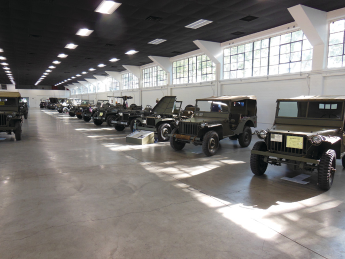 "A ""75th Anniversary of the Jeep"" display was coordinated by Dave Aro who provided is very nice slat grill Willys. This featured one of each model and significant variation of U.S. jeep-type vehicles. Well not every one, but it was an excellent and educational line up. Notable and rare jeeps included a Willys MA from Jimmy Strauss, Bantam BRC-40s from Joe Garbarino and Helen Sauer, and the #14 of 15 Willys MT-Tug brought by Robert Schoen all the way from Montana. We worked on Dave and Jay Hinton to bring a Ford GP but they brought other things! Photo by John Neuenburg."