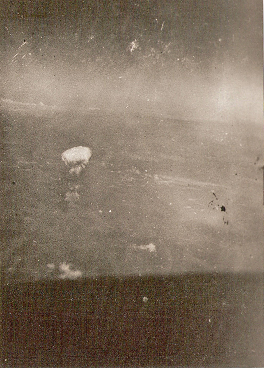 "Gackenbach shot this photo of the August 5th atomic cloud from the B-29, ""Necessary Evil."""
