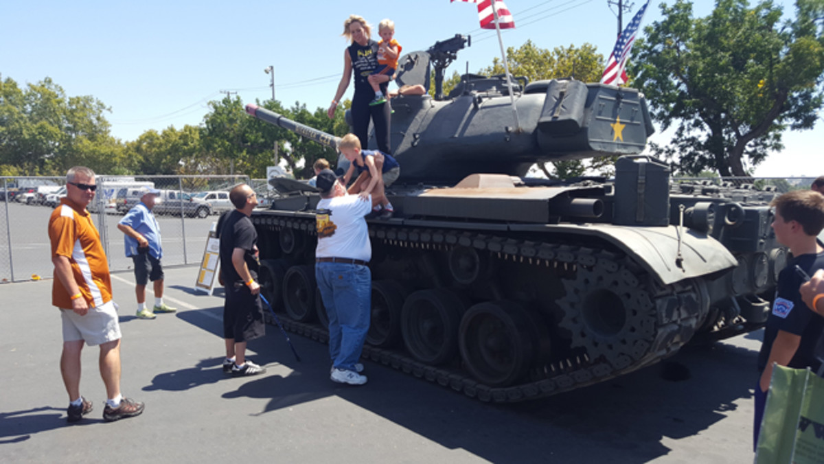 This show was blessed by having nine tanks on display! Glen Ghilotti made the jump from vintage Caterpillars to tanks by purchasing Joe Garbarino's M41 Walker Bulldog light tank and then more recently, Joe's M22 Locust airborne tank and M47 Patton main battle tank. Not only did Glen transport his tanks from Petaluma, he grabbed five more from the Garbarino collection! Here is Glen showing two young boys and their mom the M47 - a rare experience for possibly a future MV collector! Way to go Glen! Photo by John Neuenburg