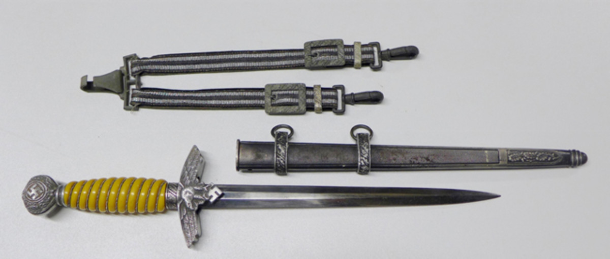 World War II German Second Model Luftwaffe dagger with sheath and hangers, maker's mark and hallmark on blade, ex Gene Christian collection.