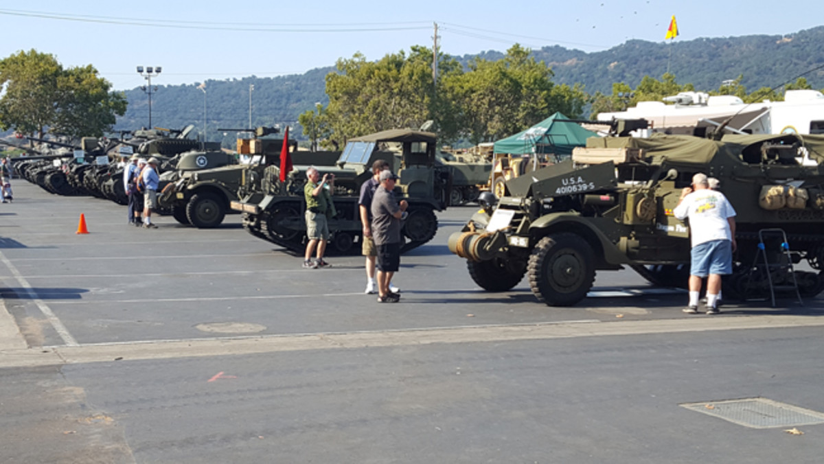 An impressive early morning lineup of vehicles face the main vendor building at Alameda County Fairgrounds. Here we see two of the handful of halftracks at the show, a Cletrac M2 aircraft tug owned by Taigh Ramey, and the eight tanks from Joe Garbarino and Glen Ghilotti. Photo by John Neuenburg