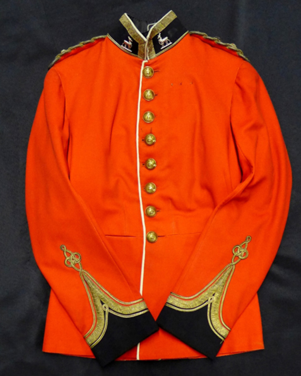 Early 20th century British officer's full dress tunic belonging to Lt. Col. John F. Elkington, accompanied by news clippings, photos and two books pertaining to Elkington, ex Gene Christian collection.