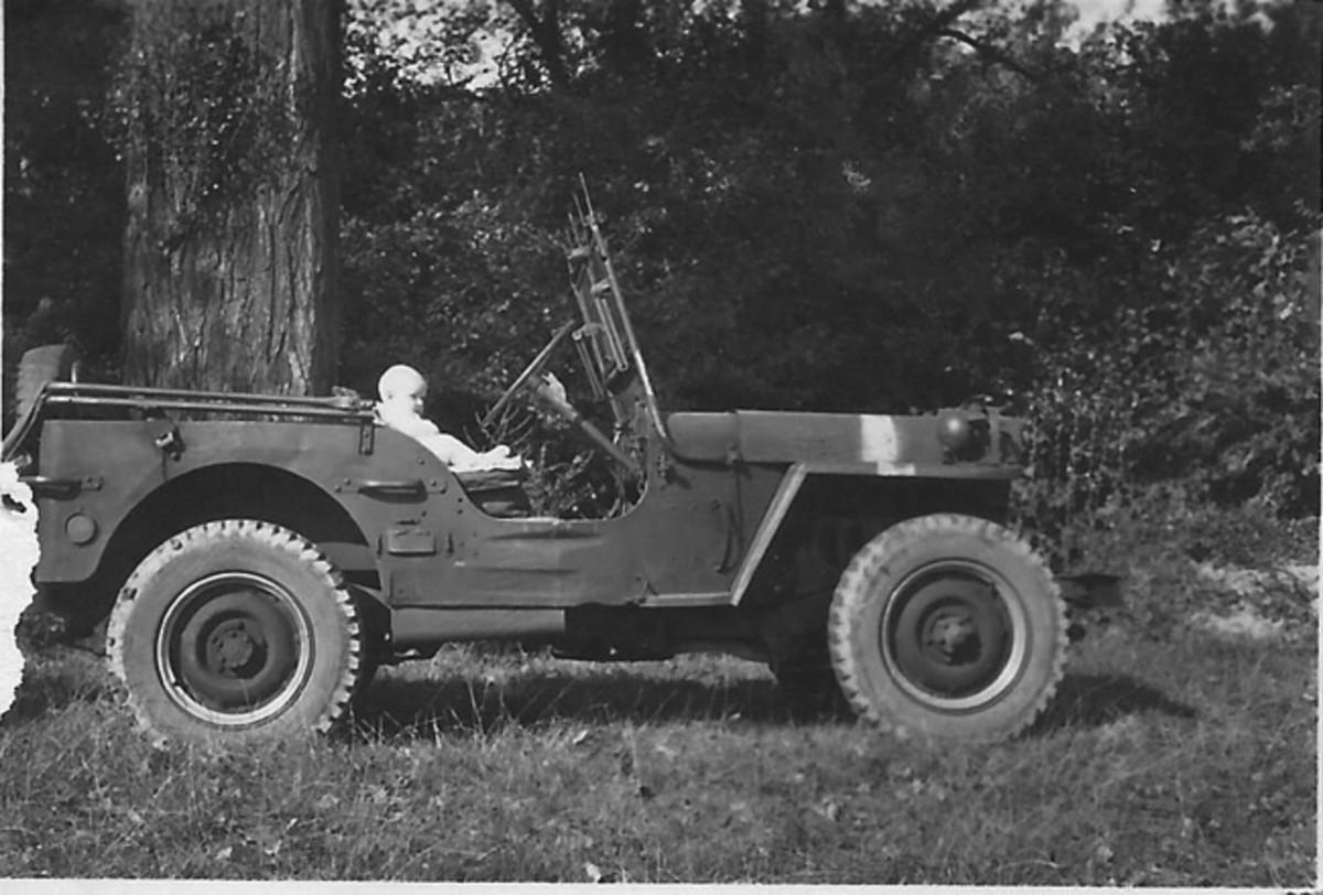 """When this photo was taken, the young """"driver,"""" John P. probably didn't realize what a significant link this Jeep would be to the history and memory of his Father."""