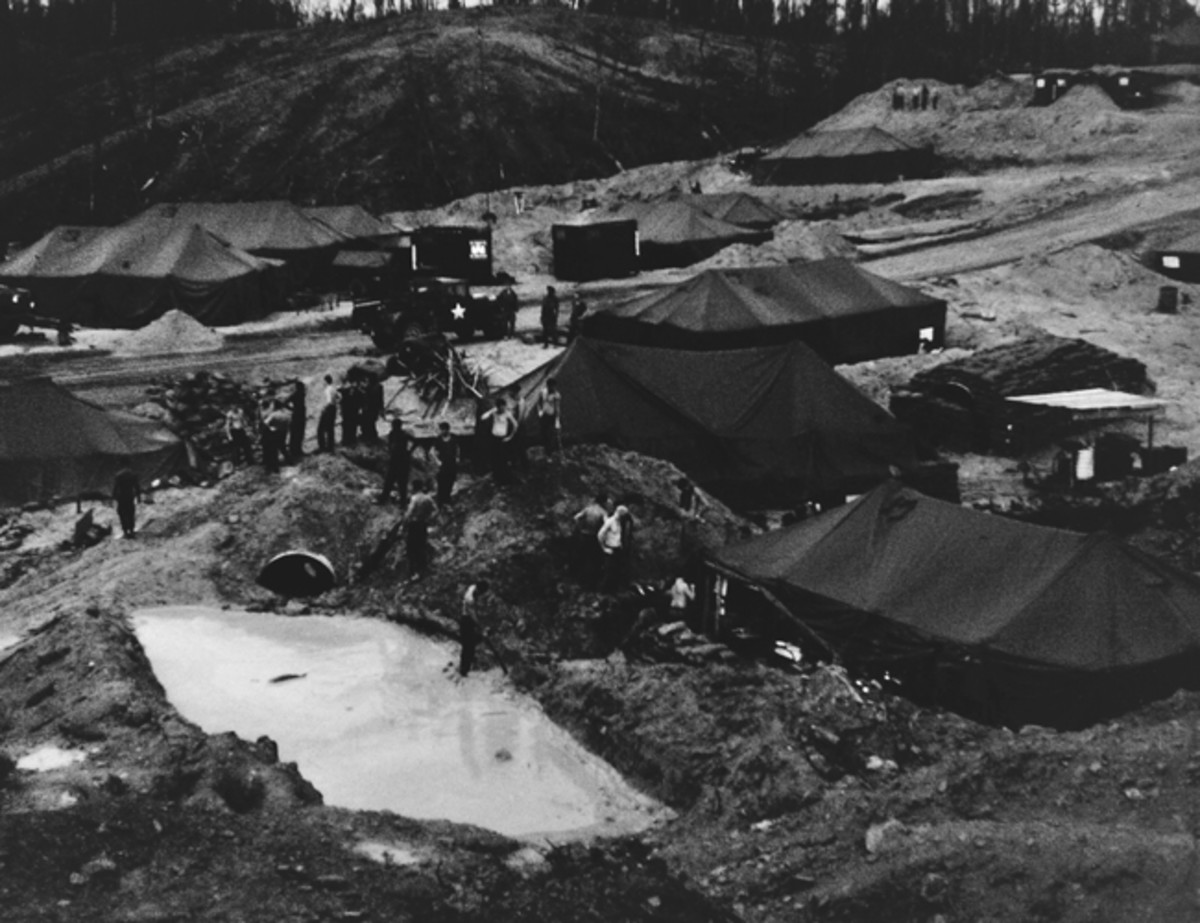Tentage and bunkers being established along the highway. The platoon is filling sandbags — a seemingly never-ending chore that everyone complained about doing but frequently were very glad to have for cover.