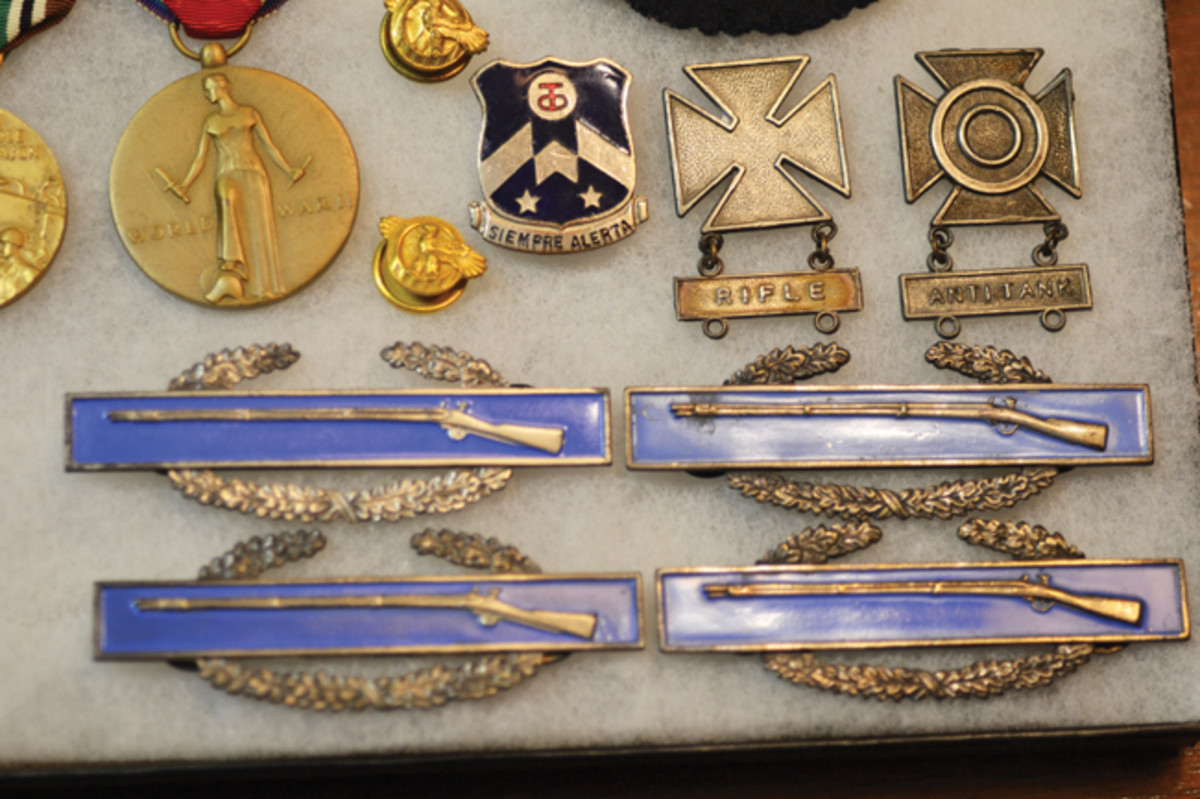 The Combat Infantryman Badges reflect Robert's battle record from Normandy through Northern France, the Rhineland, Ardennes, and Central Europe.